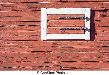 Red Log House Wall with Hatch. Detail of traditional Swedish...