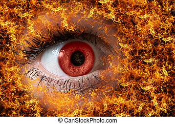 Red look on fire - extreme close-up of red female eye on...