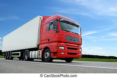 lower camera view of red lorry with white trailer on the highway over blue sky