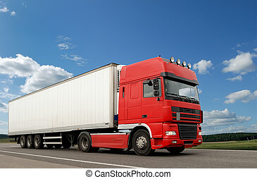 Single red lorry with white trailer over blue sky on the road. See other vans and trucks in my portfolio