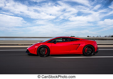 Red luxury sport car on the road
