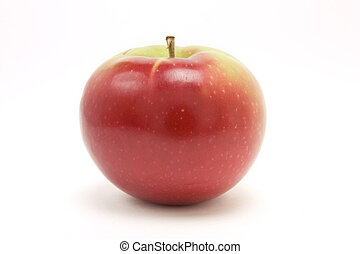 Red macintosh apple from low viewpoint isolated against ...