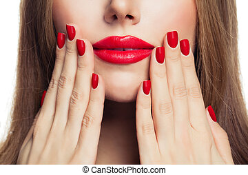 Red manicure nails and red female lips closeup