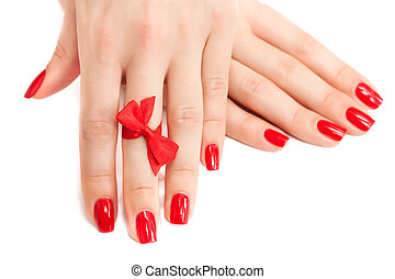 red manicure with a bow isolated