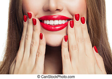 Red manicured nails and red lips makeup. Manicure and beauty concept