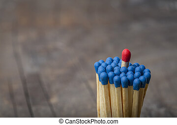 Red Match in group of blue matches