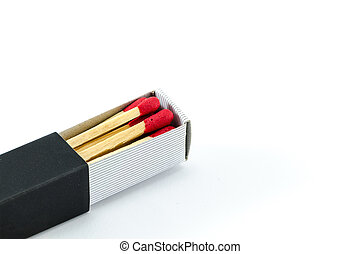 Red matchstick in black matchbox on isolated background