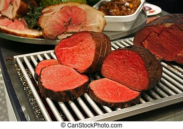 Roasted meat with meat assortment around