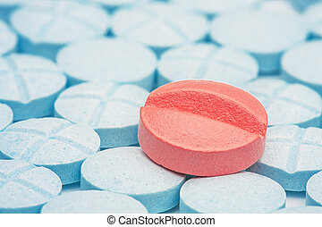red medical pills on a background of light blue pills - red ...