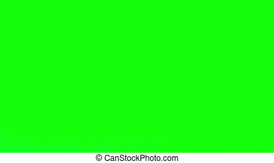 Red medication falling on green screen