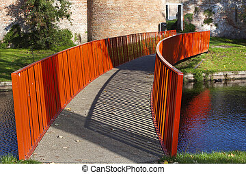Red metal bridge to the old city wall in Vianen
