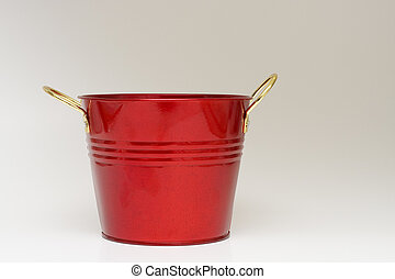 Red Metal Bucket on Gray Background