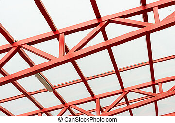 red metal construction holds a transparent roof