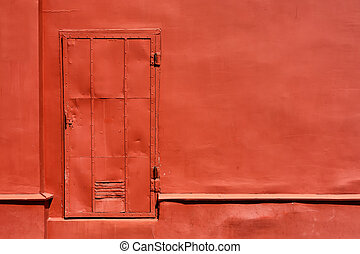 Red metal door on the painted wall