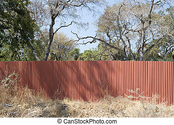 Red metal fence