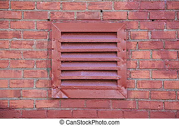 Red Metal Vent on Brick Wall