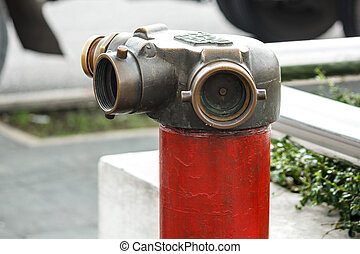 Red metallic fire hydrant or Fire Department Connection on street