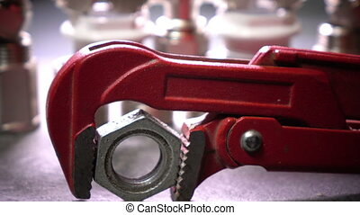 Red metalwork adjustable spanner for sanitary works against...