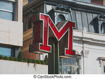 Red metro sign in the city.