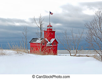 red Michigan lighthouse in winter