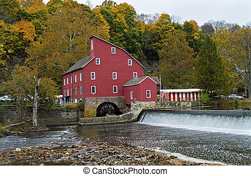 The historic Red Mill in Clinton Township in New Jersey on an overcast Autumn day.