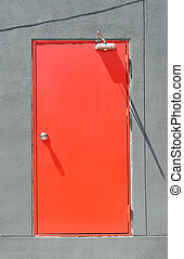 Red modern door with grey cement wall