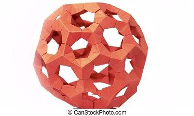 Red modular origami ball close up. Complex handmade art....