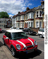 neighbor street - red moris car on neighbor street