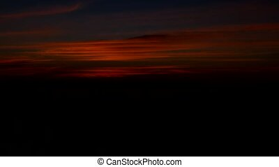 Red morning sky before dawn, time-lapse, sky before sunrise,...
