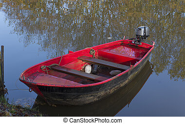 red motorboat in a canal