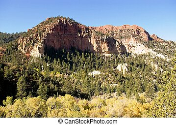 Red Mountain - An autumn scene of a steep mountain capped ...