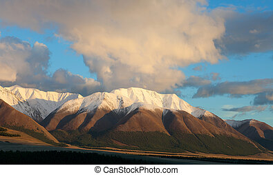 Red Mountain at sunset. Whiten the snow-capped peaks
