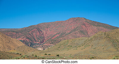 Red mountain in Morocco atlas over blue sky