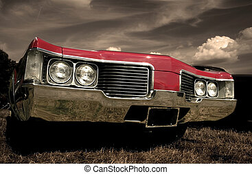 Red American muscle car with sepia color tone