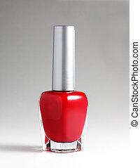 Red nail varnish at light background