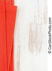 red napkin on white wooden background