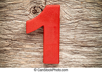 Red number one on the wooden background