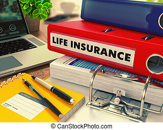 Red Office Folder with Inscription Life Insurance on Office Desktop with Office Supplies and Modern Laptop. Business Concept on Blurred Background. Toned Image.