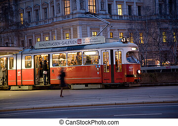 red old trolley car in Vienna in the first District by night
