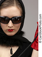 red on black - portrait of lady in black headscarf and red ...