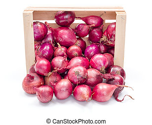 Red onion bulbs in wooden crate