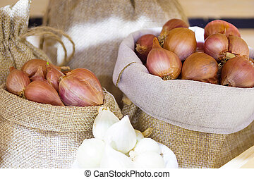 Red Onion In Fabric Bag, Bulb Onion Is Good For Health.
