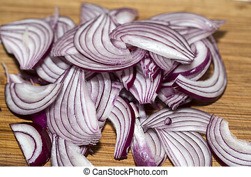 Red Onion Slices on wooden board