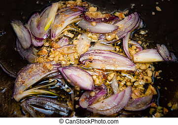 Red Onions and Pine nuts in Pan