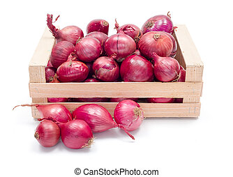 Red onions in wooden crate