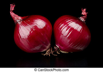 Red onions isolated on black