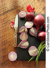 Red onions on the cutting board