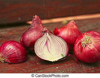 red onions on wooden country bench