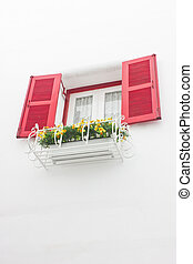 Red open window with white wall.