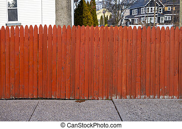 Red orange picket fence of a suburban naberhood in the united states